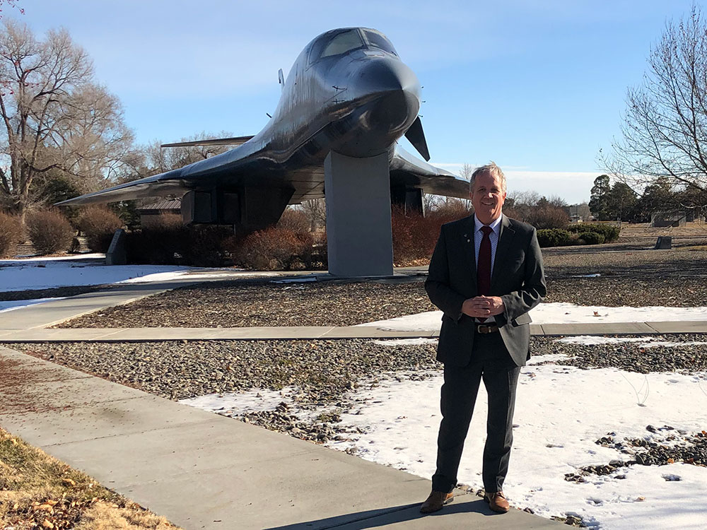Matthew Bundy posing in front of bomber in Mountain Home, Idaho.